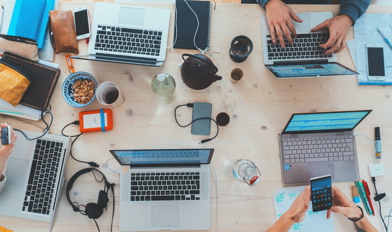 Five employees with computers affiliate marketing advantages and disadvantages